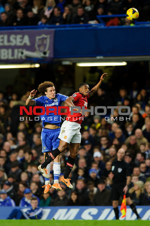 Chelsea Defender David Luiz (BRA) and Man Utd Midfielder Ashley Young (ENG) compete in the air during the match -   19/01/2014 - SPORT - FOOTBALL - Stamford Bridge, London - Chelsea v Manchester United - Barclays Premier League.<br /> Foto nph / Meredith<br /> <br /> ***** OUT OF UK *****
