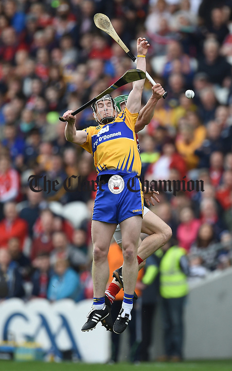 Tony Kelly of Clare in action against Colm Spillane of Cork during their Munster Senior game at Pairc Ui Chaoimh. Photograph by John Kelly.