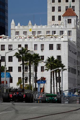 15-17 April, 2011, Long Beach, California, USA<br /> Justin Wilson chases Simona de Silvestro<br /> ©2011, Michael L. Levitt<br /> LAT Photo USA