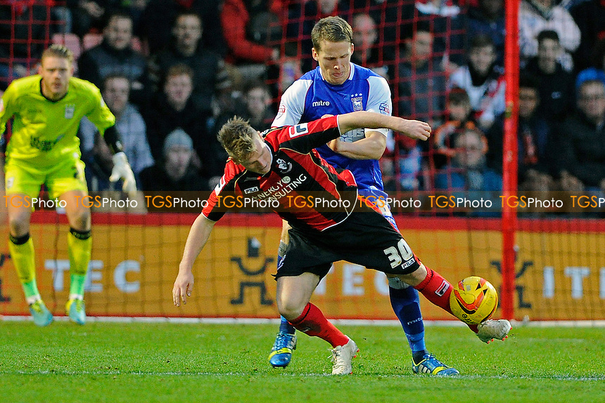 Matt Ritchie of AFC Bournemouth is held up by Christophe Berra of Ipswich Town - AFC Bournemouth vs Ipswich Town - Sky Bet Championship Football at the Goldsands Stadium, Bournemouth, Dorset - 29/12/13 - MANDATORY CREDIT: Denis Murphy/TGSPHOTO - Self billing applies where appropriate - 0845 094 6026 - contact@tgsphoto.co.uk - NO UNPAID USE