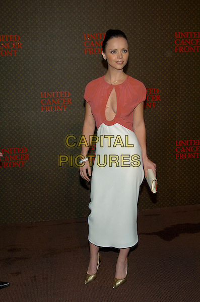 CHRISTINA RICCI.Louis Vuitton United Cancer Front Gala, Universal City, California, USA, November 8th 2004..full length skinny thin red white dress peep hole cut out.Ref: ADM.www.capitalpictures.com.sales@capitalpictures.com.©Capital Pictures.