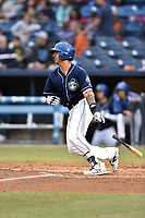 Asheville Tourists designated hitter Colton Welker (24) swings at a pitch during a game against the Kannapolis Intimidators at McCormick Field on April 18, 2017 in Asheville, North Carolina. The Intimidators defeated the Tourists 6-1. (Tony Farlow/Four Seam Images)