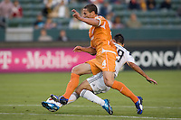 Puerto Islanders Marco Velez (4) attempts to move past LA Galaxy midfielder Vitor Pereira (19). The Puerto Rico Islanders defeated the LA Galaxy 4-1 during CONCACAF Champions League group play at Home Depot Center stadium in Carson, California on Tuesday July 27, 2010.