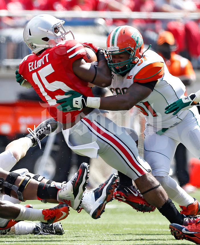 Florida A&M Rattlers linebacker Mike Ducre (51) tackles Ohio State Buckeyes running back Ezekiel Elliott (15) in the 3rd quarter during their college football game at Ohio Stadium on September 21, 2013.  (Dispatch photo by Kyle Robertson)