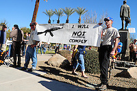 "Phoenix, Arizona. January 19, 2013 - Two men hold a banner during Saturday's rally in Phoenix to oppose to proposed changes in gun control laws. The sign reads: ""I will not comply,"" in reference to Obama's gun control plans. As President Barack Obama proposed new gun regulations last week, gun owners demonstrated against it with national ""Guns Across America"" rallies to defend the Second Amendment. Dozens showed up at the Arizona State Capitol, many of them carrying weapons. Photo by Eduardo Barraza © 2013"