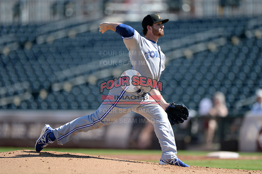 Salt River Rafters pitcher Drew Hutchison (16), of the Toronto Blue Jays organization, during an Arizona Fall League game against the Surprise Saguaros on October 14, 2013 at Surprise Stadium in Surprise, Arizona.  Salt River defeated Surprise 3-2.  (Mike Janes/Four Seam Images)