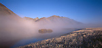 Mist and fog over a small lake in the Ahuriri Valley. Canterbury. New Zealand.
