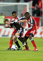 16 April 2011: D.C. United midfielder Dax McCarty #10 battles with Toronto FC midfielder Tony Tchani #22 and Toronto FC midfielder Julian de Guzman #6 during an MLS game between D.C. United and the Toronto FC at BMO Field in Toronto, Ontario Canada..D.C. United won 3-0.