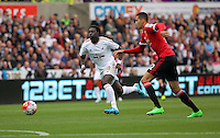Pictured L-R: Bafetimbi Gomis of Swansea against Chris Smalling of Manchester United Sunday 30 August 2015<br /> Re: Premier League, Swansea v Manchester United at the Liberty Stadium, Swansea, UK