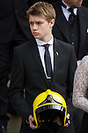 © Joel Goodman - 07973 332324 . 02/09/2013 . Bury , UK . Stephen Hunt's son Sam carries a fireman's helmet . The funeral of fireman Stephen Hunt at Bury Parish Church today (Tuesday 3rd September 2013) . Stephen Hunt died whilst tackling a blaze at Paul's Hair World in Manchester City Centre in July 2013 . Photo credit : Joel Goodman
