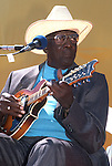 """Yank Rachell, Sept 1990, San Francisco Blues Festival. American blues musician, dubbed an """"elder statesman of the blues."""" His career as a performer spanned nearly seventy years, and was often teamed with the guitarist and singer Sleepy John Estes. Though a capable guitarist and singer, he was better known as a master of the blues mandolin. By the mid 1990s, Henry Townsend and his one-time collaborator Rachell were the only active blues artists whose performing lives stretched back to the 1920s."""