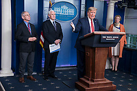 United States President Donald J. Trump delivers remarks on the COVID-19 (Coronavirus) pandemic alongside members of the Coronavirus Task Force in the Brady Press Briefing Room at the White House in Washington, DC, March 25, 2020, in Washington, D.C. Standing behind the President from left to right: Director of the National Institute of Allergy and Infectious Diseases at the National Institutes of Health Dr. Anthony Fauci; US Vice President Mike Pence; and Dr. Deborah L. Birx, White House Coronavirus Response Coordinator.<br /> Credit: Sarah Silbiger / Pool via CNP/AdMedia