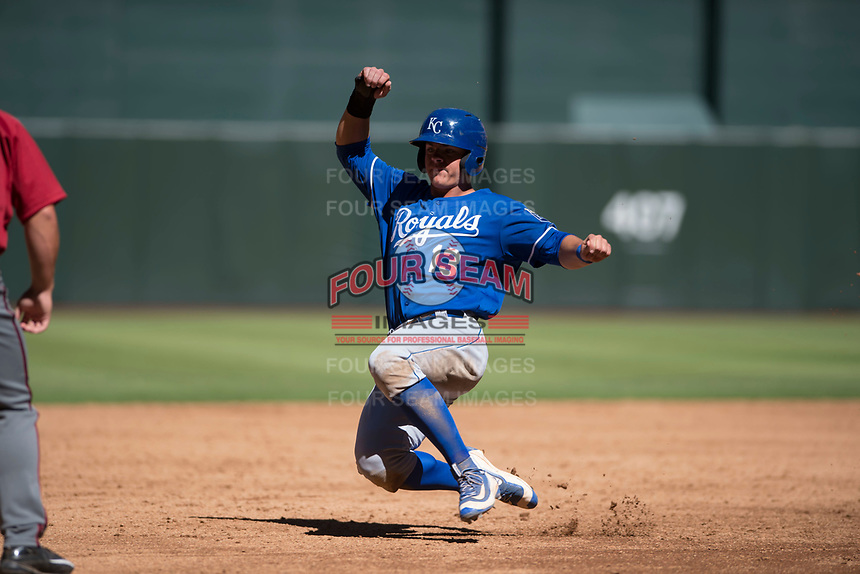 Kansas City Royals first baseman Nick Pratto (13) slides into third base during an Instructional League game against the Arizona Diamondbacks at Chase Field on October 14, 2017 in Scottsdale, Arizona. (Zachary Lucy/Four Seam Images)