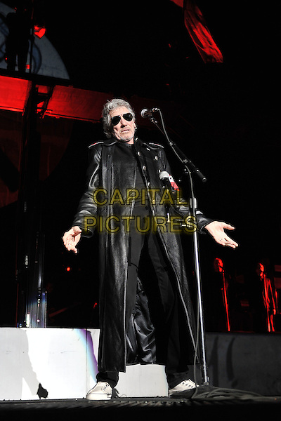 Roger Waters performing 'The Wall' in its entirety at Birmingham NIA (National Indoor Arena), England..27th June, 2011.on stage gig concert live performance music full length singing sunglasses black long leather jacket hands arms.CAP/MAR.© Martin Harris/Capital Pictures.
