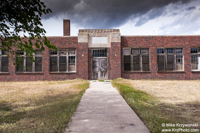 Old abandoned brick school building in Park, KS