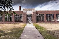Old abandoned brick school building in Park, KS
