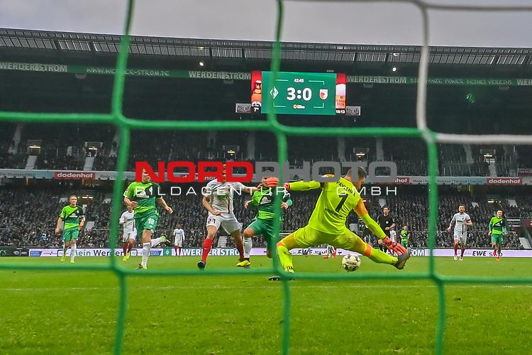 10.02.2019, Weser Stadion, Bremen, GER, 1.FBL, Werder Bremen vs FC Augsburg, <br /> <br /> DFL REGULATIONS PROHIBIT ANY USE OF PHOTOGRAPHS AS IMAGE SEQUENCES AND/OR QUASI-VIDEO.<br /> <br />  im Bild<br /> Jiri Pavlenka (Werder Bremen #01)<br /> rettet vor Sergio Córdova / Cordova (FC Augsburg #21) <br /> Philipp Bargfrede (Werder Bremen #44)<br /> <br />  Aufgenommen mit der Hintertor Remote Kamera<br /> Foto © nordphoto / Kokenge