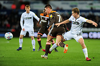 Sergi Canós of Brentford battles with George Byers of Swansea City during the Sky Bet Championship match between Swansea City and Brentford at the Liberty Stadium in Swansea, Wales, UK. Tuesday 02 April 2019