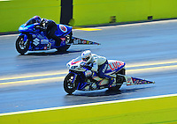 Sept. 25, 2011; Ennis, TX, USA: NHRA pro stock motorcycle rider Hector Arana Jr (near lane) races alongside Jim Underdahl during the Fall Nationals at the Texas Motorplex. Mandatory Credit: Mark J. Rebilas-