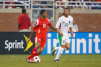 Panama midfielder Nelson Barahona (10) and Guadeloupe defender Mickael Tacalfred (22) during the CONCACAF soccer match between Panama and Guadeloupe at Ford Field Detroit, Michigan.