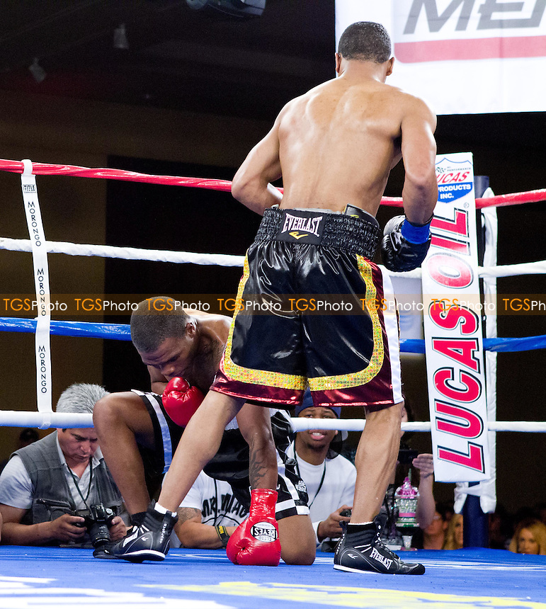 Kendall Holt in black with multicolor trim defeats Tim Coleman in black with white trim shorts in a welterweight boxing contest - ESPN Friday Night Fights at the Morongo Casino Resort & Spa in Cabezon, California - 16/3/2012 - Dwight McCann/TGSPHOTO - Self billing applies where appropriate - 0845 094 6026 - contact@tgsphoto.co.uk - NO UNPAID USE