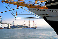 """With the bow of the Russian merchant marine full-rigged training ship the Pallada in the foreground the Cuauhtémoc passes in front of Treasure Island in San Francisco Bay.<br /> <br /> Delivered to its crew in 1982 the Mexican Navy three masted Barque Cuauhtémoc has sailed waters all over the world representing Mexico's Navy. The ships primary mission is training naval cadets as well as educating captains, officers, cadets, and crew members in navigation sailing maneuvers.<br /> <br /> Cuauhtémoc, whose name means """"eagle that swoops down over its prey"""" was the last emperor of the Aztecs. Born around AD 1495 he is still revered in Mexico with many parks, plazas, and a sailing vessel named after him. Lynched by the Spaniards in 1525 he said to Cortes: <br /> """"I knew what it was...to trust to your false promises; I knew that you had destined me to this fate since I did not fall by my own hand when you entered my city of Tenochtitlan."""""""