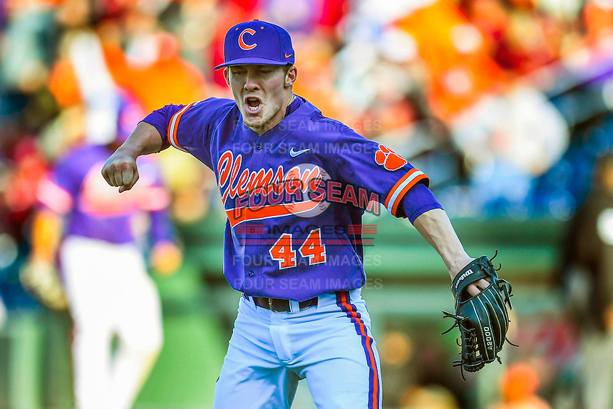 Closer Ryley Gilliam (44) of the Clemson Tigers pumps his fist as he records the final strikeout to beat the South Carolina Gamecocks in the Reedy River Rivalry game on Saturday, March 4, 2017, at Fluor Field at the West End in Greenville, South Carolina. Clemson won, 8-7. (Tom Priddy/Four Seam Images)