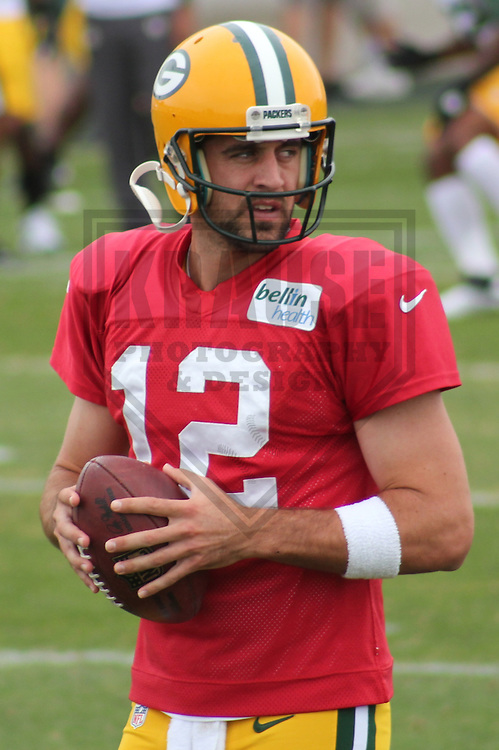 GREEN BAY - AUGUST 2011: Aaron Rodgers (12) of the Green Bay Packers during a Training Camp practice on August 13, 2012 at Ray Nitschke Field in Green Bay, Wisconsin. (Photo by Brad Krause).  .www.krausesportsphotography.com