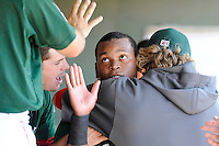 Third baseman Rafael Devers (13) of the Greenville Drive gets a hug from pitcher Michael Kopech after scoring in a game against the Charleston RiverDogs on Sunday, June 28, 2015, at Fluor Field at the West End in Greenville, South Carolina. Devers is the No. 6 prospect of the Boston Red Sox, according to Baseball America. Charleston won, 12-9. (Tom Priddy/Four Seam Images)