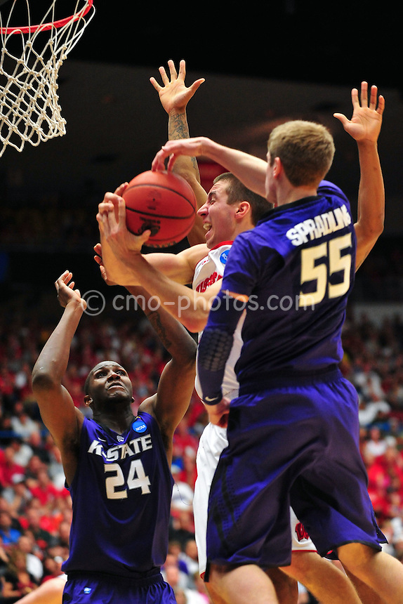 Mar 19, 2011; Tucson, AZ, USA; Wisconsin Badgers guard Josh Gasser (21) is fouled in the first half of a game against the Kansas State Wildcats in the third round of the 2011 NCAA men's basketball tournament at the McKale Center.