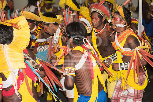 Kayapo warriors from the remote village of Gorotire dressed in traditional feather headdress and beadwork dance during a cultural presentation at the first ever International Indigenous Games, in the city of Palmas, Tocantins State, Brazil. The games will start with an opening ceremony on Friday the 23rd October. Photo © Sue Cunningham, pictures@scphotographic.com 21st October 2015