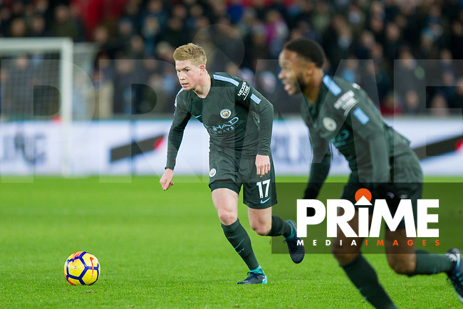 Kevin De Bruyne of Manchester City looks to pass through to Raheem Sterlingn (foreground) during the EPL - Premier League match between Swansea City and Manchester City at the Liberty Stadium, Swansea, Wales on 13 December 2017. Photo by Mark  Hawkins / PRiME Media Images.