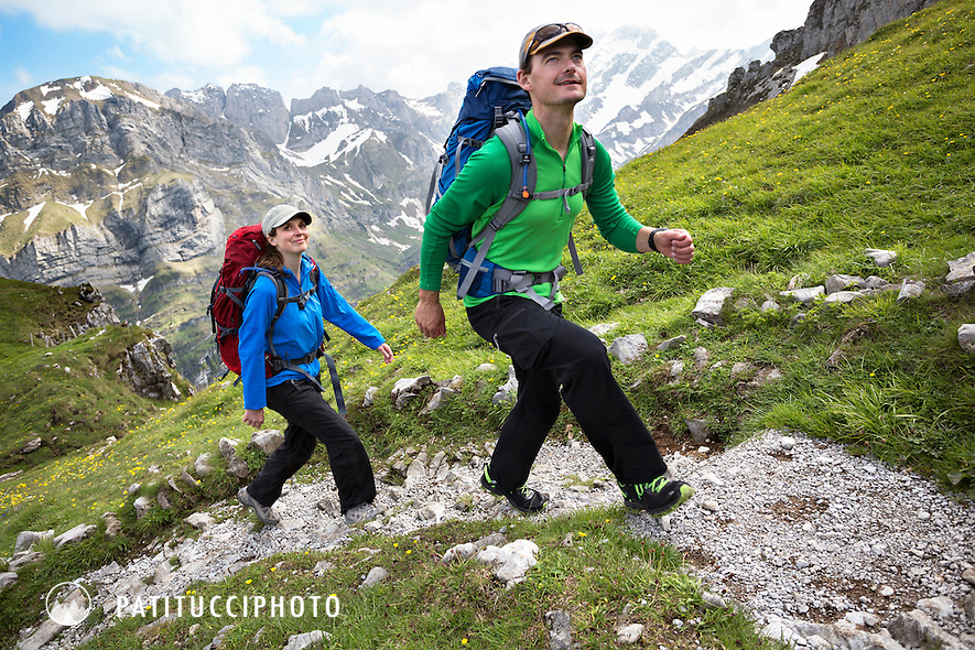 Two people hiking in the Ebenalp area of the Alpstein group, Appenzell region, Switzerland