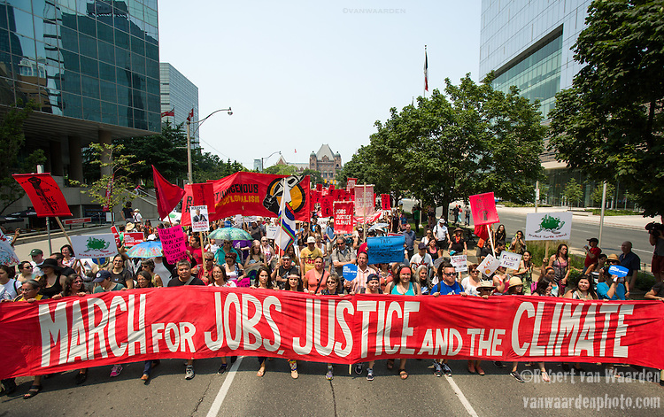 On July 5th more than 10,000 people gathered in Toronto, the traditional territories of the Missisauga peoples, for the March for Jobs, Justice and the Climate. The march told the story of a new economy that works for people and the planet. People marched for an economy that starts with justice, creates good work, clean jobs and healthy communities. The people recognize that we have solutions and we know who is responsible for causing the climate crisis. (Photo: Robert van Waarden)