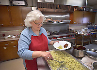 STAFF PHOTO BEN GOFF  @NWABenGoff -- 09/28/14 Harriet Mack volunteers in the kitchen during a meal at First United Methodist Church in Rogers served by volunteers with Samaritan Community Center as a way for church members to learn about the center and it's work on Sunday September 28, 2014. The meal is part of a series of events examining the hunger problem in Northwest Arkansas.
