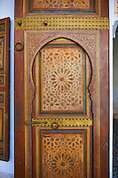 Berber Arabesque painted wood door .The Petite Court, Bahia Palace, Marrakesh, Morroco
