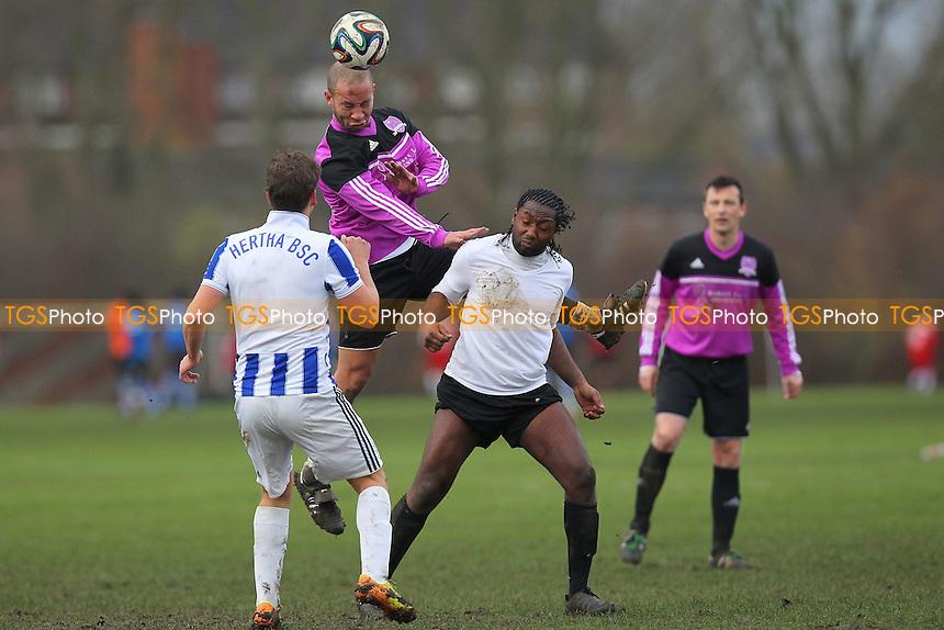RL United (purple) vs FC Haggerston - Hackney & Leyton Sunday League Dickie Davies Cup Football at South Marsh, Hackney Marshes, London - 07/12/14 - MANDATORY CREDIT: Gavin Ellis/TGSPHOTO - Self billing applies where appropriate - 0845 094 6026 - contact@tgsphoto.co.uk - NO UNPAID USE