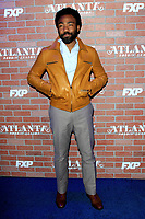 "LOS ANGELES - FEB 19:  Donald Glover at the ""tlanta Robbin"" LA Premiere Screening at the Theatre at Ace Hotel on February 19, 2018 in Los Angeles, CA"