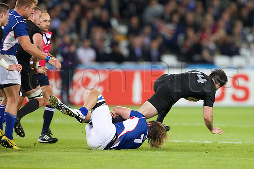 24.09.2015. Olympic Stadium, London, England. Rugby World Cup. New Zealand versus Namibia. Namibia flanker Tinus du Plessis tackles New Zealand All Black wing Nehe Milner-Skudder.