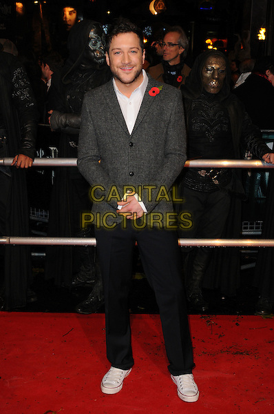 "MATT CARDLE.""Harry Potter And The Deathly Hallows: Part 1"" World Film Premiere, Empire cinema Leicester Square and Odeon Leicester Square, London, England, UK, 11th November 2010. .full length grey gray jacket white shirt poppy beard facial hair converse trainers black trousers wool blazer .CAP/CAS.©Bob Cass/Capital Pictures."