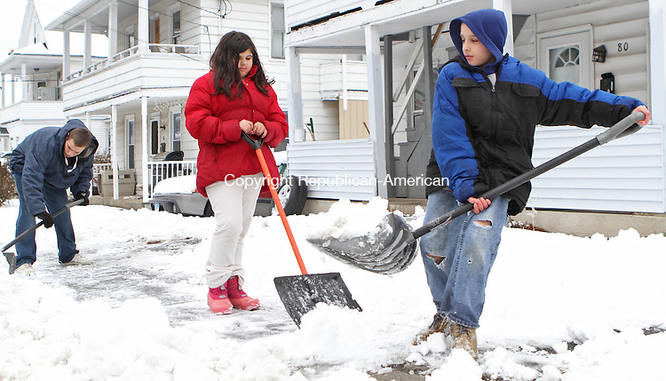 Torrington, CT-24 January 012415MK12 Kevin Cooley, Tatyana Pemberton and Anthony Albright clear the four inches of fresh snow from the sidewalk along Workman Avenue in Torrington Saturday afternoon. Michael Kabelka / Republican-American