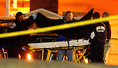 """Falls Church, VA - October 14, 2002 -- The body of perhaps the latest  """"Beltway Sniper"""" shooting is placed on a gurney to  transport it  from the parking lot of the Home Depot. The victim was killed by a single gunshot and may me the latest victim of the """"Beltway Sniper"""".<br /> Credit: Ron Sachs / CNP<br /> (RESTRICTION: NO New York or New Jersey Newspapers or newspapers within a 75 mile radius of New York City)"""