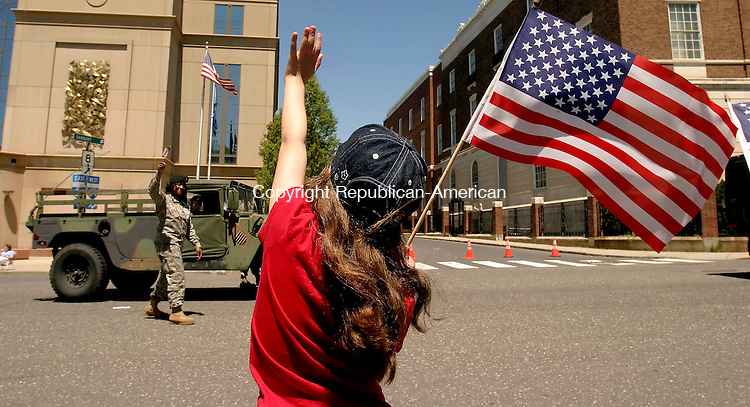 WATERBURY, CT- 25 MAY 2008 --052508JS09-Michaela Hernendez, 7, of Waterbury, waves to military personnel as they march in the annual Waterbury Memorial Day parade on Sunday. <br /> Jim Shannon / Republican-American