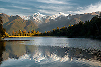 Lake Matheson with Mt. Cook right 3754m and Mt. Tasman left 3497m reflecting in lake, Westland NP, West Coast, New Zealand