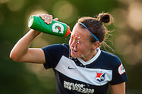 Sky Blue FC defender Caitlin Foord (4) cools off. Sky Blue FC defeated the Boston Breakers 5-1 during a National Women's Soccer League (NWSL) match at Yurcak Field in Piscataway, NJ, on June 1, 2013.