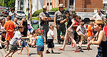 Two State Troopers stand watch over a street closed to traffic along the route of the Saugerties July 4th Parade on Main Street in Saugerties, NY on Monday, July 4, 2011. Photo by Jim Peppler. Copyright © Jim Peppler 2011.