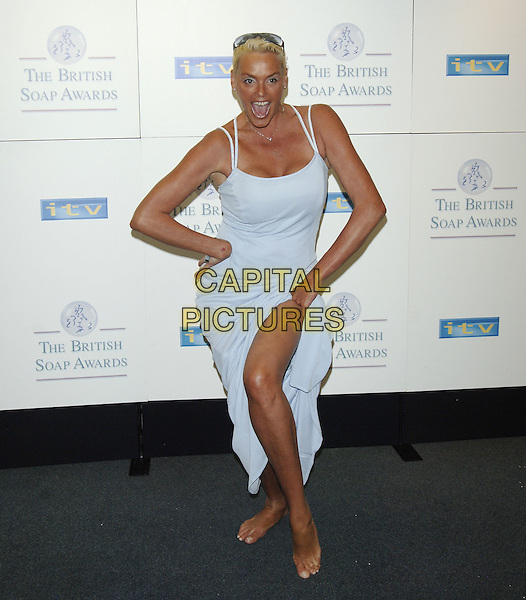 BRIGITTE NIELSEN.British Soap Awards - Press Room.BBC Television Centre, W12, London.May 7th, 2005.Bridgette Nielson.Ref: PL.full length blue dress funny barefoot posing slit split.www.capitalpictures.com.sales@capitalpictures.com.©Capital Pictures.