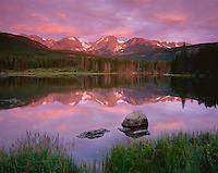 Rocky Mountain National Park, CO<br /> Dawn reflections on Otis Peak, Hallett Peak, and Flattop Mountain with  reflections from Sprague Lake