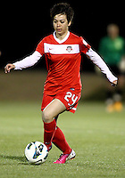 BOYDS, MARYLAND - April 06, 2013:  Diana Weigel (24) of The Washington Spirit moves the ball down field against the University of Virginia women's soccer team in a NWSL (National Women's Soccer League) pre season exhibition game at Maryland Soccerplex in Boyds, Maryland on April 06. Virginia won 6-3.