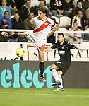 Rayo Vallecano's Jordi Figueras against Valencia's Antonio Barragan during La Liga match. November 26, 2011. (ALTERPHOTOS/Alvaro Hernandez)